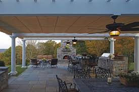 working creating patio: two kampa clients are working together to create outdoor living environments such as this