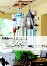 outdoor lighting ideas outdoor. Outdoor Hanging Chandelier Using Lanterns. #backyard #deck #patio #porch  #outdoorliving Outdoor Lighting Ideas