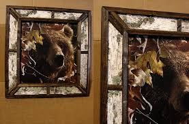 gorgeous close up of a bear in autumn oak leaves framed with real birch bark and wood