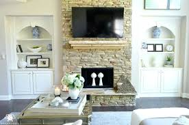 stone fireplace with built ins built ins on either side of stone fireplace in living room stone fireplace with built ins