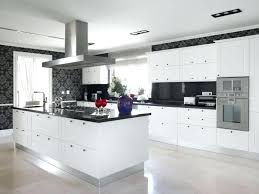 white cabinets dark this striking contemporary kitchen utilizes black counters and bold accent wallpaper to break up the inspiring kitchens with granite