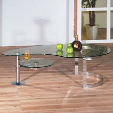 The gentle curve of the metal base. Unique Glass Coffee Tables Ideas On Foter