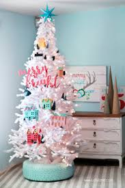 Recycled tire Christmas tree base. Spray paint your old tire with several  coats of good paint (aqua color in this