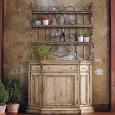 distressed kitchen buffet featuring unique tendrils wooden back details and rustic bottom triple diffe facing drawers with knob and upper graded open