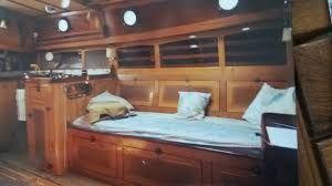 an obviously lovingly built custom interior looking at the port side of the main cabin