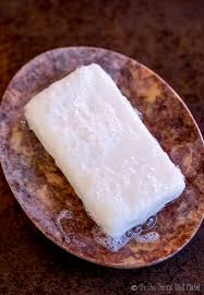 closeup of a homemade shampoo bar in a stone soap dish