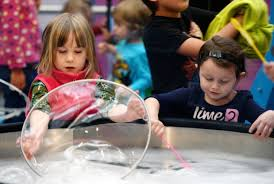 Children of all ages including Myra Tucker 5, (left) and Maddy Anderson 4,  were taking part in the first new year's party of the day held at the  Saskatchewan Science Centre Tuesday December 31 2013.