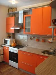 Shades of orange paint Interiors Blue Wall Paint And Orange Kitchen Cabinets Contemporary Kitchen Design Dreamstimecom 25 Ideas For Modern Interior Decorating With Orange Color Shades