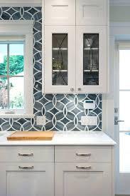 tile backsplash for white kitchen blue tile white and blue kitchen boasts white shaker cabinets painted tile backsplash