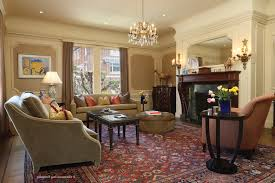 living room oriental room brown gy area rug leather sofa colorful rug this is