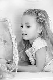 black child looking in mirror. beautiful little girl looking to retro mirror \u2014 photo by evdoha black child in