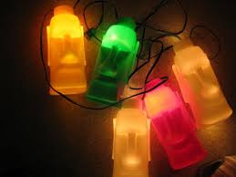 tiki lighting. Hi, I Have 2 Sets Of Moai String Lights For Sale. One Is Large And Set Small. Auction Ends Friday Nite. Both Strands Work 7 Light Covers On Each Tiki Lighting