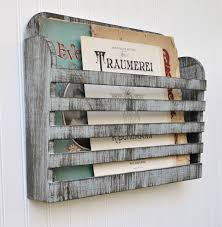 Decorative Magazine Storage Old And Vintage Wall Mounted Magazine Organizer On White Wall