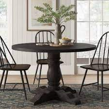 This classic farmhouse dining table is formed from reclaimed pine and hand finished to preserve the natural beauty and variation of the wood grain. Pin By Linda Kooy On New House Ideas In 2021 Black Round Dining Table Round Kitchen Table Round Dining Table Decor