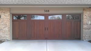 Clopay Canyon Ridge Collection stained faux wood garage door The