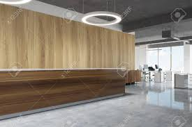 light office. Stock Photo - Wooden Reception Desk Is Standing In A Modern Office With Concrete Floor, Light Walls And Round Ceiling Lamps.