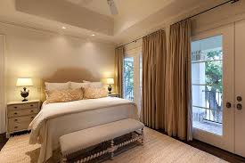 beige cottage bedroom with french doors view full size
