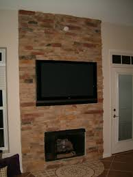 tv above fireplace with no mantle