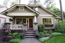 A charming bungalow, beautifully landscaped. Not a tiny house, but it is a cute  small house none-the-less.