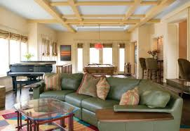 paneled ceiling and colorful decor help create this unique living room plan