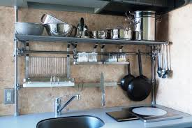 image of stainless steel kitchen shelves wall