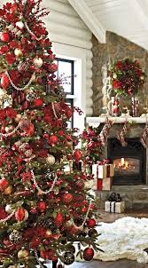 This Christmas tree is loaded with red ornaments of different kinds. The  plaid ornaments are standing out from the rest. The cranberries, especially  are ...