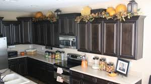 decorating above kitchen cabinets with high ceilings modern best regarding 26 decorating tops of kitchen cabinets r23 kitchen