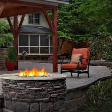 this charlotte outdoor living space has it all areas for shade sun dining outdoor fireplaces