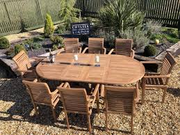 teak extending table with 8 stacking