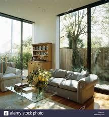 Modern Patio Doors Grey Sofa In Front Of Patio Doors In Modern White Living Room