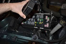 how to replace a fuse in your 2005 2009 ford mustang open the fuse box