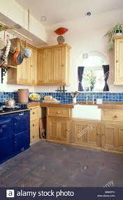 Blue Floor Tiles Kitchen Blue Aga In Fitted Pine Kitchen With Butlers Sink And Dark Grey