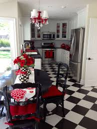 fun and unique black and white kitchen with red accents and a checkerboard floor want additional info on the image homedecorforless