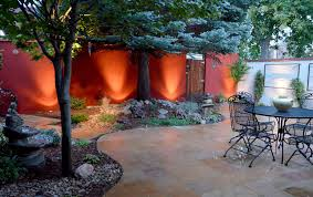 artistic outdoor lighting. 12 volt landscape lighting highlights the deep color of this artistic courtyard outdoor