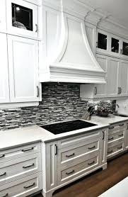 black or grey linear glass tile with crisp white cabinetry and marble backsplash ideas kitchen cabinets
