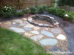 cool wood fencing design with pea gravel patio and stone paver also firepit with shrubs how to