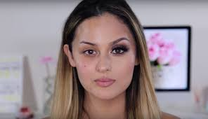 a beauty ger wearing makeup on half of her face and no makeup on the other