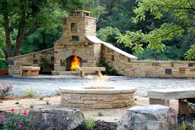 you can see this fireplace at cherokee stone center we have examples of our stone work at our stone center outside kitchen firepit