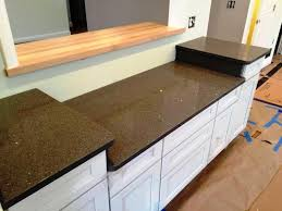 dark gray quartz countertop white cabinets