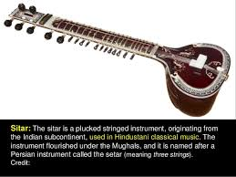 The ghatam is a mud pan with a narrow mouth. Music Instruments Of India 1 3