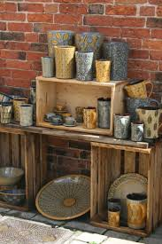 Great idea to display pottery at craft shows using crates. Gives pottery a  different vibe