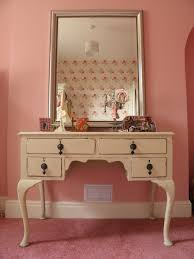 furniture rectangle white wooden makeup table with drawers and rectangle silver mirror on pink wall