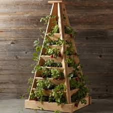this 4 foot tall vertical pyramid shaped planter is handcrafted from untreated western cedar that is naturally rot and insect resistant and is designed to