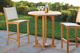encompasses extraordinary comfort and value w a solid teak frame aluminum hardware and durable phifertex fabric the bar chair coordinates perfectly w
