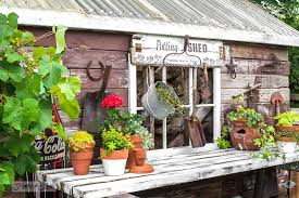 potting shed sign on a rustic garden