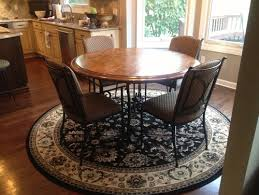 need help on what shape rug to put under round kitchen round dining table cowhide rug