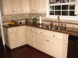 antique white kitchen cabinets with granite countertops dark