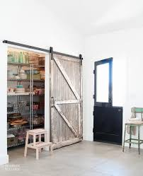 kitchen pantry with distressed barn door