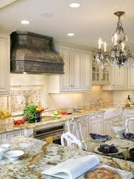 white traditional kitchen with chandeliers and creative countertop
