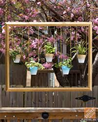 patio decorating ideas diy thrifted frame with hanging plants